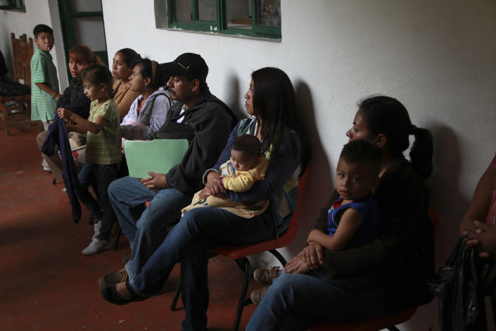 In this Tuesday, July 10, 2012 photo, parents wait to try to get their children's U.S. birth certificate stamped by Mexican authorities in Malinalco, Mexico. Because of the Byzantine rules of Mexican and U.S. bureaucracies, tens of thousands of U.S. born children of Mexican migrant parents now find themselves without access to basic services in Mexico - unable to officially register in school or sign up for health care at public hospitals and clinics that give free check-ups and medicines. (AP Photo/Dario Lopez-Mills)