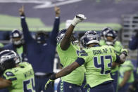 Seattle Seahawks defensive end Carlos Dunlap (43) celebrates with defensive end L.J. Collier, center-left, after Dunlap sacked Arizona Cardinals quarterback Kyler Murray late in the second half of an NFL football game, Thursday, Nov. 19, 2020, in Seattle. The Seahawks won 28-21. (AP Photo/Lindsey Wasson)