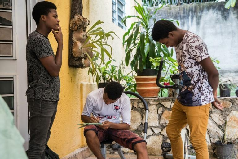 The Bosquet brothers -- Evensky, 18 (L), Reevens, 20 (C), and Valens, 22 -- are staying at a cousin's house because their neighborhood is riddled with crime, and have fallen behind with their schooling