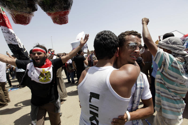 Egyptians hugs celebrate following a life sentence for ousted president Hosni Mubarak outside the police academy courtroom in Cairo, Egypt, Saturday, June 2, 2012. Egypt's ex-President Hosni Mubarak was sentenced to life in prison Saturday for his role in the killing of protesters during last year's revolution that forced him from power, a verdict that caps a stunning fall from grace for a man who ruled the country as his personal fiefdom for nearly three decades. (AP Photo/Amr Nabil)