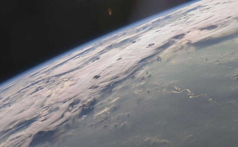 A picturesque line of thunderstorms and numerous circular cloud patterns filled the view as the International Space Station (ISS) Expedition 20 crew members looked out at the limb (blue line on the horizon) of the Earth. The region shown in the astronaut photograph (top image) includes an unstable, active atmosphere forming a large area of cumulonimbus clouds in various stages of development. The crew was looking west-southwest from the Amazon Basin, along the Rio Madeira toward Bolivia when the image was taken.