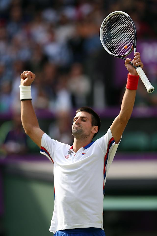 LONDON, ENGLAND - AUGUST 01: Novak Djokovic of Serbia celebrates after defeating Lleyton Hewitt of Australia in the third round of Men's Singles Tennis on Day 5 of the London 2012 Olympic Games at Wimbledon on August 1, 2012 in London, England. (Photo by Clive Brunskill/Getty Images)