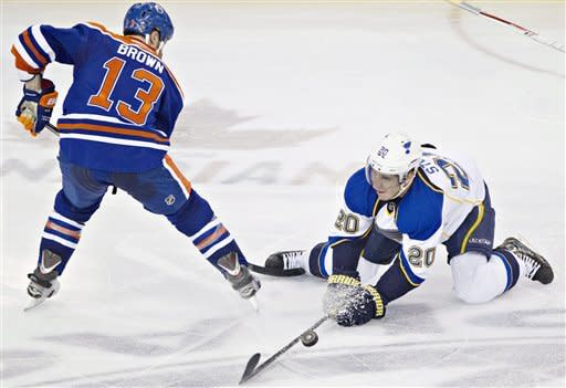 St. Louis Blues' Alexander Steen, right, battles for the puck with Edmonton Oilers' Mike Brown during second period NHL hockey action in Edmonton, Alberta, on Saturday March 23, 2013. (AP Photo/The Canadian Press, Jason Franson)