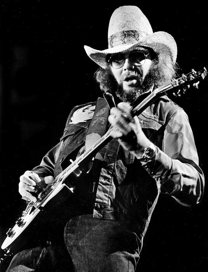 """Hank Williams Jr. lays down some guitar licks for 9,000 screaming fans during his and David Allan Coe concert at the sold out Murphy Center on the campus of Middle Tennessee State University in Murfreesboro, Tenn. April 21, 1985. One of Williams biggest hits is """"Family Tradition."""""""