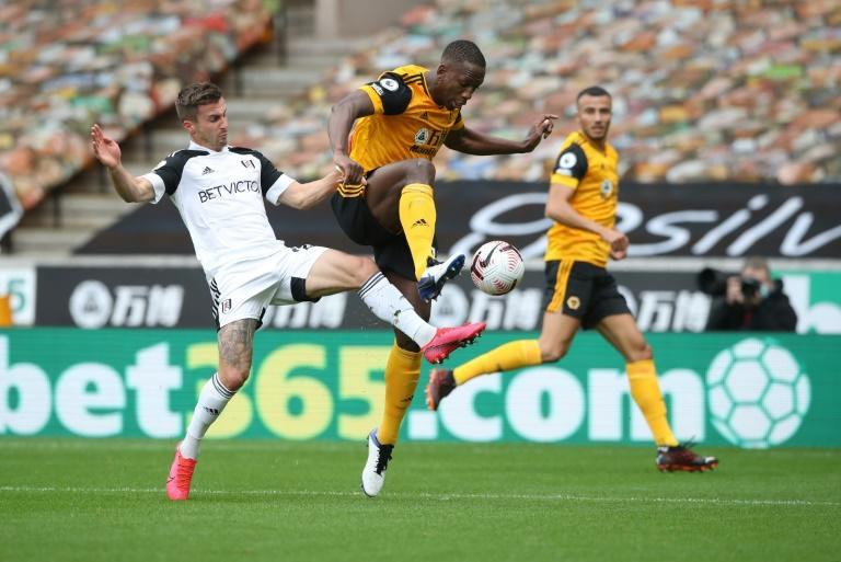 Wolves defender Willy Boly (C) in action against Fulham in the English Premier League this month.