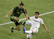 Portland Timbers midfielder Diego Valeri, left, goes after a ball with Los Angeles FC defender Mohamed El-Munir, right, during the second half of an MLS soccer match in Portland, Ore., Sunday, Oct. 18, 2020. The match ended in a 1-1- draw. (AP Photo/Steve Dykes)