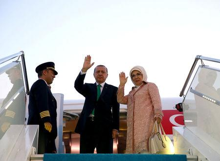 Turkish President Tayyip Erdogan, accompanied by his wife Emine Erdogan, waves as he departs for Warsaw to attend a NATO summit, in Istanbul, Turkey, July 7, 2016.  Kayhan Ozer/Presidential Palace/Handout via REUTERS