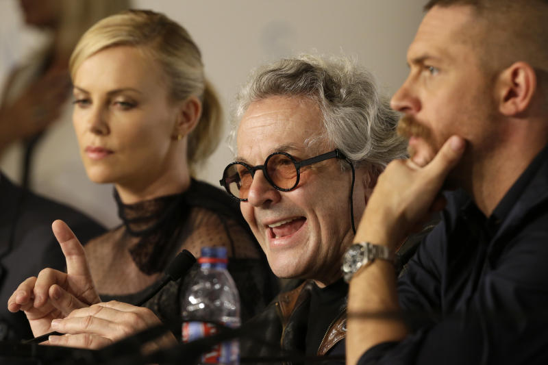 Director George Miller, center, speaks alongside Charlize Theron, left, and Tom Hardy during a press conference for the film Mad Max: Fury Road at the 68th international film festival, Cannes, southern France, Thursday, May 14, 2015. (AP Photo/Lionel Cironneau)