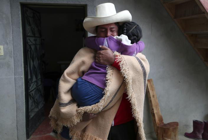 Free Peru party presidential candidate Pedro Castillo hugs his daughter Alondra who cries for him not to leave home, as he prepares to campaign in Chugur, Peru, Thursday, April 15, 2021. Castillo will face rival candidate Keiko Fujimori in the June 6 presidential run-off election. (AP Photo/Martin Mejia)