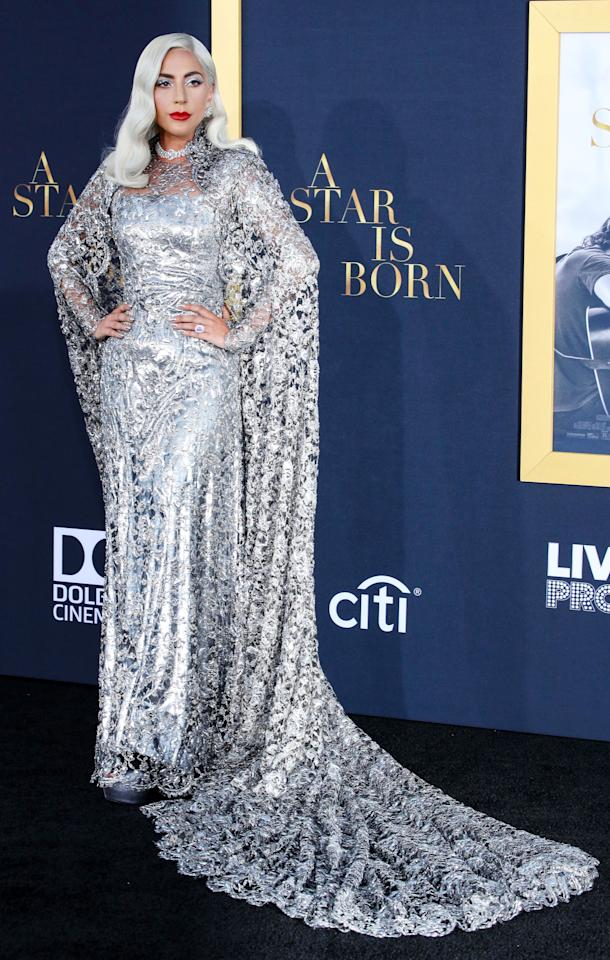 "<p>Lady Gaga wore a custom made silver gown by Givenchy for the ""A Star Is Born"" film premiere in Los Angeles on 24 September 2018. [Photo: Rex] </p>"