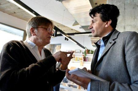 ALDE President and Former Belgium Prime Minister Guy Verhofstadt chats with Reuters journalist Peter Maushagen during the kick-off campaign of La Republique En Marche Benelux, in Brussels, Belgium, April 7, 2018. Picture taken April 7, 2018. REUTERS/Eric Vidal