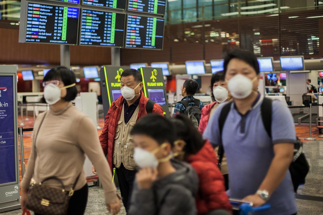 A family seen wearing protective n95 masks as they walk around Changi Airport in Singapore. Many people have started wearing protective masks in many places around the world due to the fear of Wuhan coronovirus outbreak. Ten people tested positive for the Wuhan coronavirus in Singapore as of 29th January 2020- as reported by the country's Ministry of Health (MOH). (Photo by Maverick Asio / SOPA Images/Sipa USA)