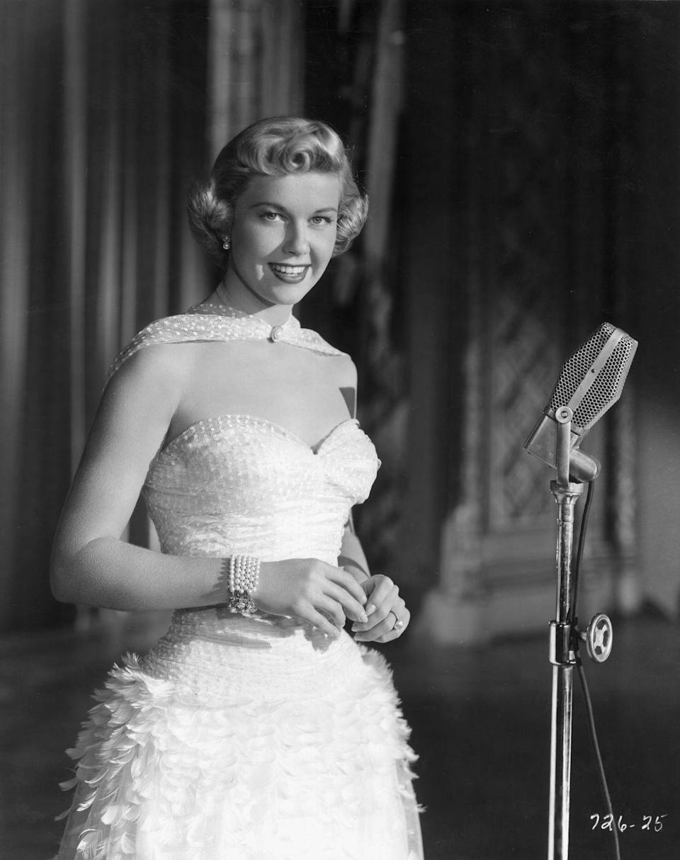 """<p>One of the year's biggest hit songs? Doris Day's """"It's Magic."""" And the singer's name also rose in popularity, at No. 64. Linda, Mary, and Barbara continued to rank in the top 3, while James, Robert, and John maintained their lead on the boys' charts.</p>"""