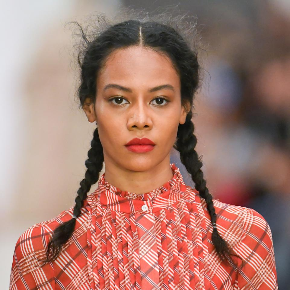 """Makeup artist Janeen Witherspoon channeled Frieda Kahlo, one of Bora Aksu's muses this season, with lush red lips set against clean skin and pearl-highlighted lids. Witherspoon packed the lip with Lisa Eldridge's highly coveted Velvet Ribbon lipstick (completely sold out online) and added more definition with <a href=""""https://shop-links.co/1684406643245360476"""" rel=""""nofollow"""">MAC's Cherry lip pencil</a> for a rocking red lip. """"It's based on Frieda Kahlo, Maria Berrio, and Persian princess Taj Saltaneh,"""" Witherspoon said of the inpo this season. """"Bora had a vision of having all three of them together and what they would do for women's rights so we wanted the girls to have this really strong, powerful mouth."""" She then blurred out <a href=""""https://camerareadycosmetics.com/products/ben-nye-luxe-powder"""" rel=""""nofollow"""">Ben Nye's Luxe Powder</a> in Ice on the lid, inner corner of the eye, and across the cheekbone."""