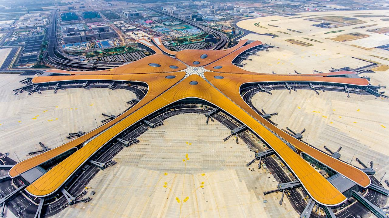 The Beijing Daxing International Airport resembles a massive shining starfish. (Photo by STR / AFP) / China OUT / To go with China-Aviation, Focus by Patrick Baert (Photo credit should read STR/AFP/Getty Images)