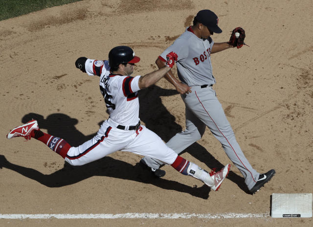Boston Red Sox relief pitcher William Cuevas, right, forces out Chicago White Sox's Ryan LaMarre at first during the fifth inning of a baseball game Sunday, Sept. 2, 2018, in Chicago. (AP Photo/Nam Y. Huh)