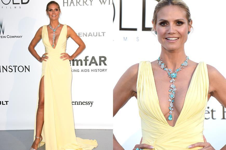 <p>Ray of sunshine: In 2016 Heidi looked absolutely stunning in a pale yellow gown with a very plunging neckline. Hey, if you find a look that suits you, you should roll with it. And that's definitely what Heidi has done. She does have a lot of experience in the fashion world, after all.</p>