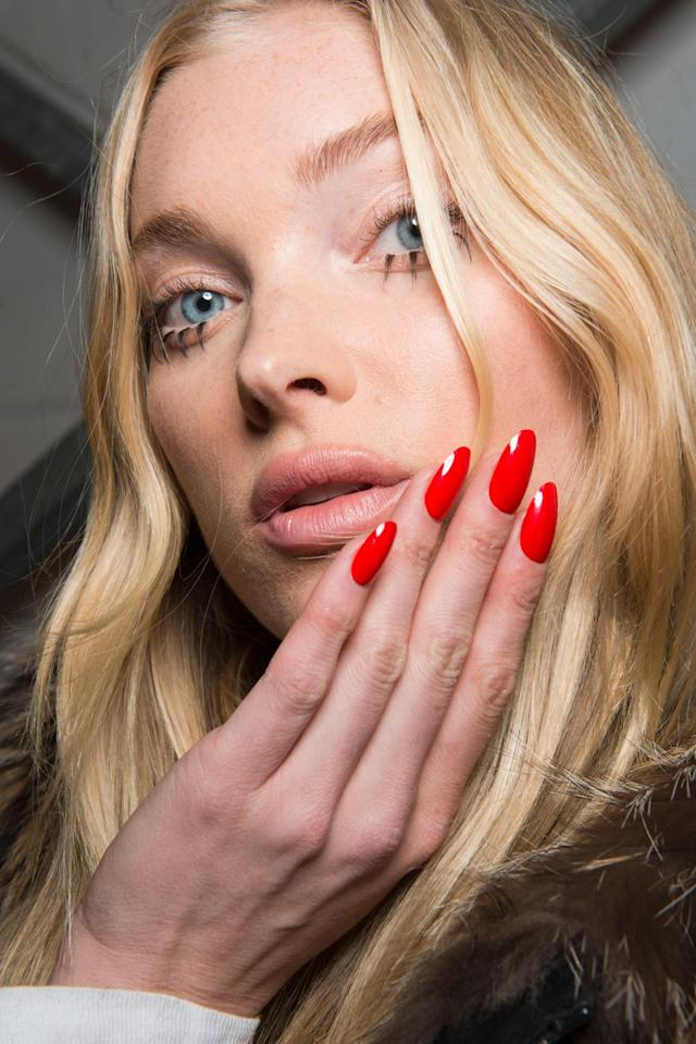 <p>Red-hot pointy nails. (Photo: Imaxtree) </p>