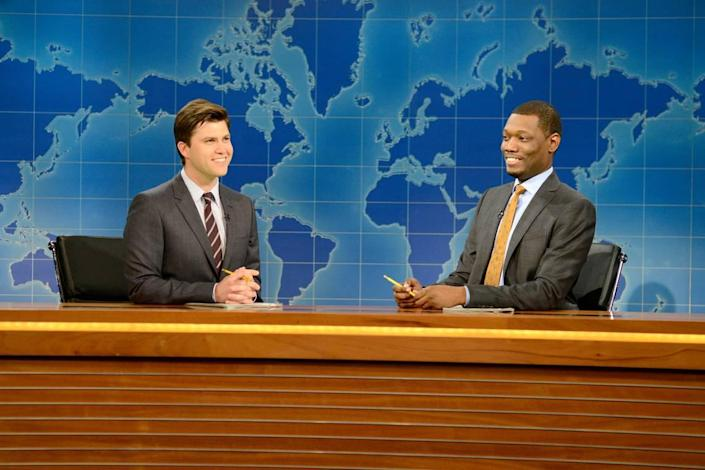 """SATURDAY NIGHT LIVE -- """"Jim Carrey"""" Episode 1666 -- Pictured: (l-r) Colin Jost and Michael Che during """"Weekend Update"""" on October 25, 2014 -- (Photo by: Dana Edelson/NBC)"""