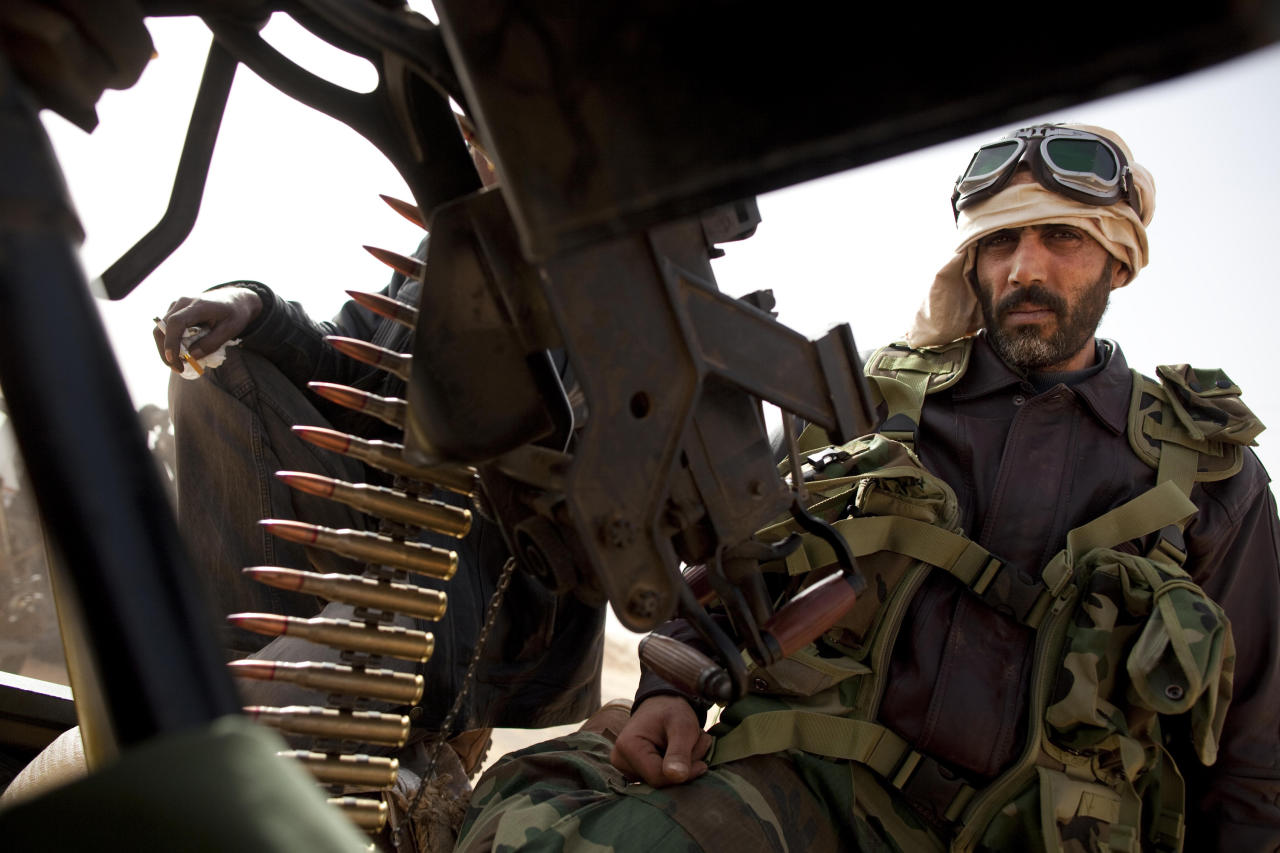 Libyan rebels who are part of the forces against Libyan leader Moammar Gadhafi sits on a truck with a heavy machine gun after capturing the oil town of Ras Lanuf, in eastern Libya, Saturday, March 5, 2011. Rebel fighters have captured the key oil port of Ras Lanouf from the forces of Moammar Gadhafi, in their first military victory in a potentially long, westward march from the east of the country to the capital Tripoli hundreds of miles to the west.