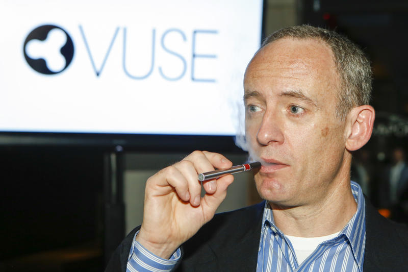 IMAGE DISTRIBUTED FOR VUSE - R.J. Reynolds Vapor Company Vice-President Fred Ampolini demonstrates VUSE Digital Vapor Cigarette to local media at Philadelphia's Hotel Monaco Wednesday, June 18, 2014. VUSE will be available Monday, June 23 in more than 15,000 retail outlets across all 50 states. (Mark Stehle/AP Images for VUSE)