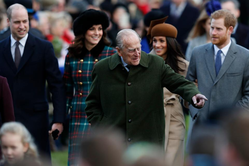 Britain's Prince Philip, Duke of Edinburgh (C) gestures as he is followed by (L-R) Britain's Prince William, Duke of Cambridge, Britain's Catherine, Duchess of Cambridge, US actress and fiancee of Britain's Prince Harry Meghan Markle and Britain's Prince Harry arriving to attend the Royal Family's traditional Christmas Day church service at St Mary Magdalene Church in Sandringham, Norfolk, eastern England, on December 25, 2017. / AFP PHOTO / Adrian DENNIS        (Photo credit should read ADRIAN DENNIS/AFP via Getty Images)