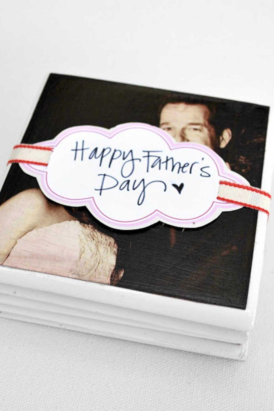 """<p>Give dad a way to cherish old memories forever with these easy-to-make coasters.</p><p><em><strong>Get the tutorial at </strong><a href=""""http://arrowandheart.blogspot.ro/2011/06/fathers-day-diy-coasters.html"""" rel=""""nofollow noopener"""" target=""""_blank"""" data-ylk=""""slk:Arrow and Heart"""" class=""""link rapid-noclick-resp""""><strong>Arrow and Heart</strong></a><strong>. </strong></em></p>"""