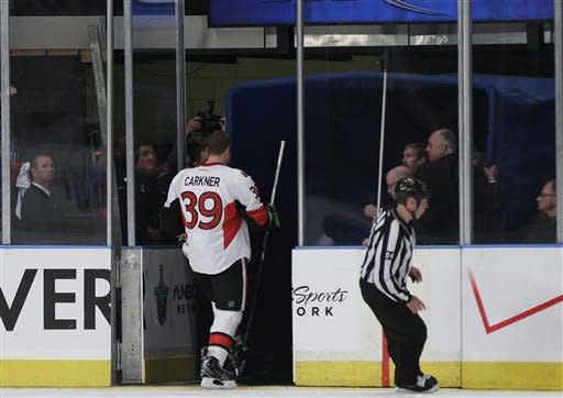 Ottawa Senators' Matt Carkner (39) leaves the ice during the first period of Game 2 of a first-round NHL hockey playoff series against the New York Rangers Saturday, April 14, 2012, in New York. (AP Photo/Frank Franklin II)