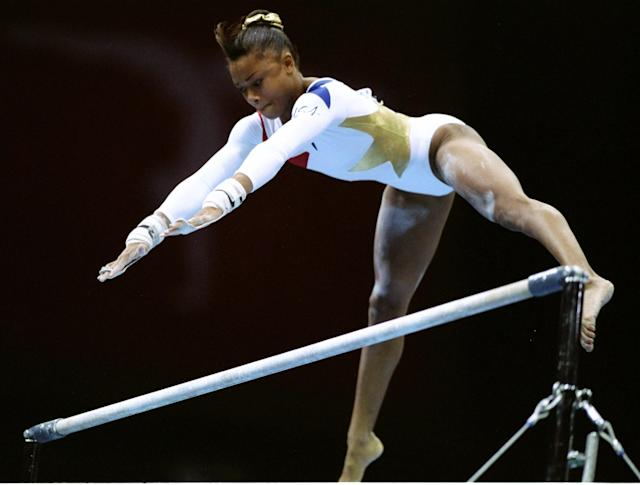 25 Jul 1996: Dominique Dawes of the USA in action in the womens individual all around final at the Georgia Dome at the 1996 Centennial Olympic Games in Atlanta Georgia.