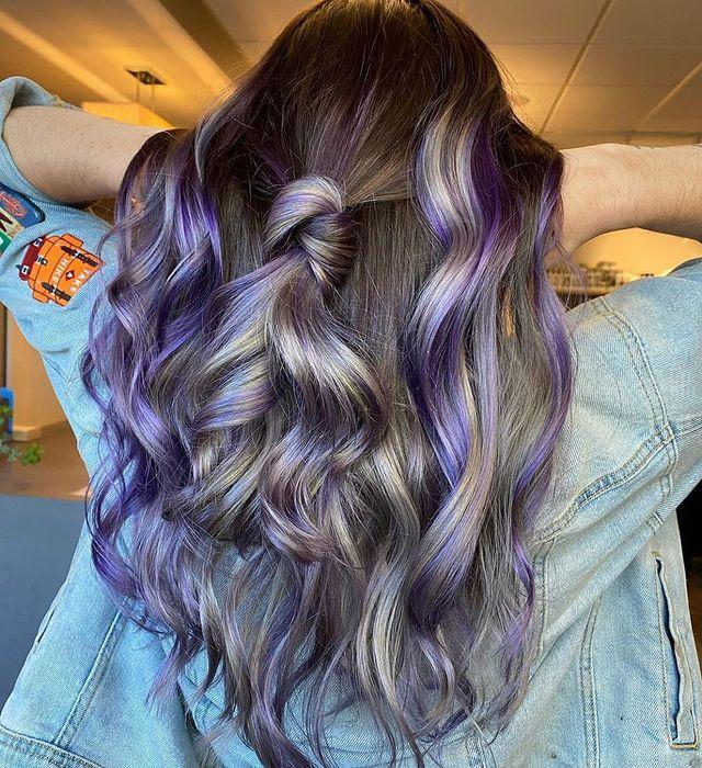"""<p>If you've got the fear about dyeing your whole head purple, these smoky lilac highlights will gently ease you in.</p><p><a href=""""https://www.instagram.com/p/CDtZM1Ajj-6/"""" rel=""""nofollow noopener"""" target=""""_blank"""" data-ylk=""""slk:See the original post on Instagram"""" class=""""link rapid-noclick-resp"""">See the original post on Instagram</a></p>"""