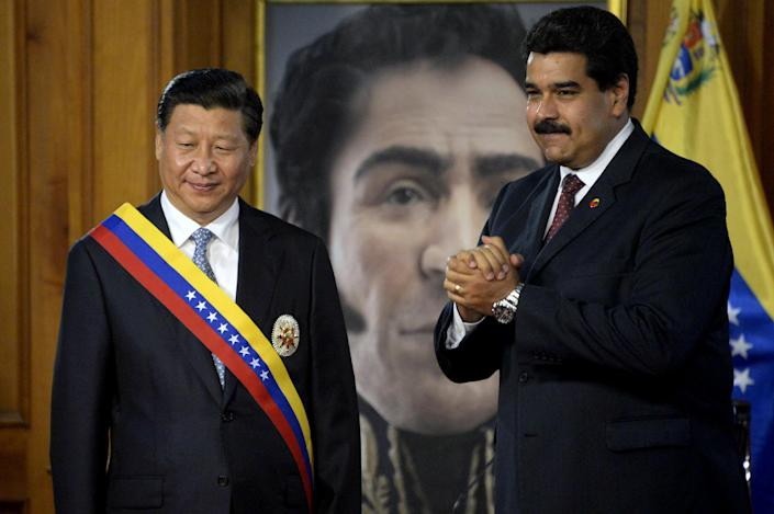 Nicolas Maduro (right) with Xi Jinping during an official visit to Miraflores Presidential Palace, Caracas on July 20, 2014 (AFP Photo/Leo Ramirez)