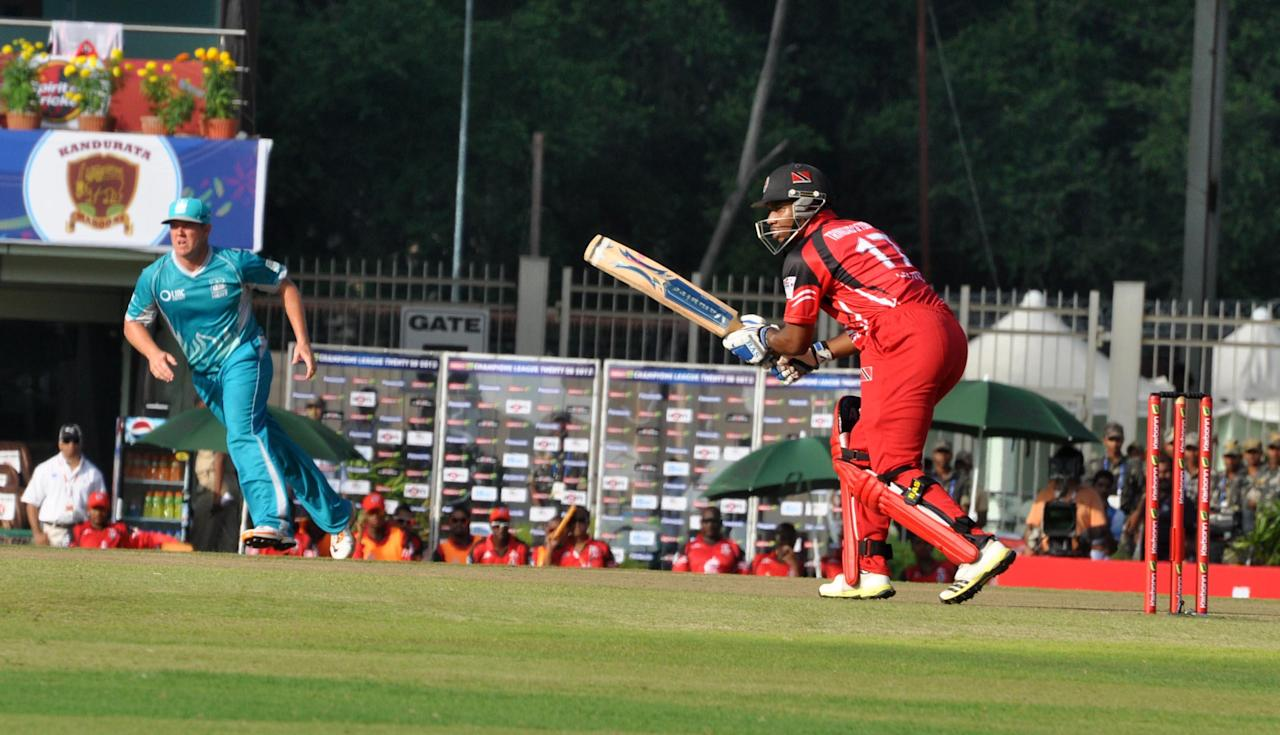 Players in action during the Champions League T20, 2nd match, Group B between Brisbane Heat and Trinidad & Tobago at JSCA International Cricket Stadium, Ranchi on Sept. 22, 2013. (Photo: IANS)