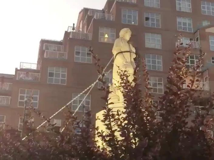 Protesters pull down the statue of Christopher Columbus in Baltimore: SPENCER COMPTON via REUTERS