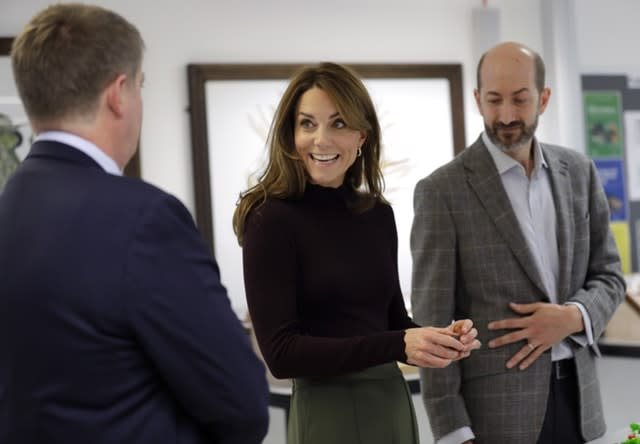 Kate, centre, met with Dr John Tweddle, right, during her visit