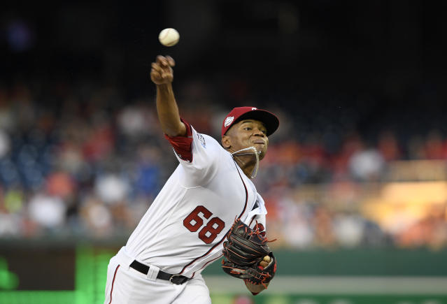 Washington Nationals starting pitcher Jefry Rodriguez delivers during the first inning of a baseball game against the Philadelphia Phillies, Sunday, June 24, 2018, in Washington. (AP Photo/Nick Wass)