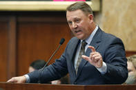 Rep. Jason White, R-West, introduces a bill to remove the Confederate battle emblem from the Mississippi flag, Sunday, June 28, 2020, at the Capitol in Jackson, Miss. The bill passed and heads to the Senate. (AP Photo/Rogelio V. Solis)