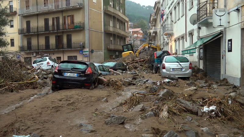 Still image taken from video shows cars submerged from flash floods in Bitti