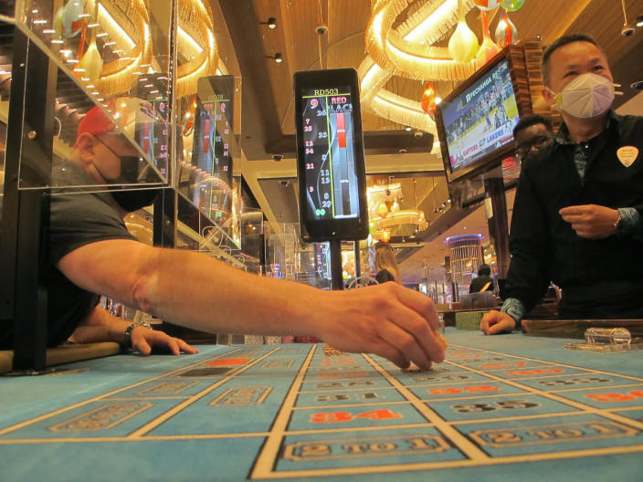 In this May 3, 2021 photo a game of roulette is under way in the Hard Rock casino in Atlantic City, N.J. On May 11, the American Gaming Association released statistics showing that the U.S. commercial casino industry matched its best quarter ever in terms of revenue in the first three months of 2021, taking in more than $11.1 billion as customers continued returning amid the COVID-19 pandemic. (AP Photo/Wayne Parry)