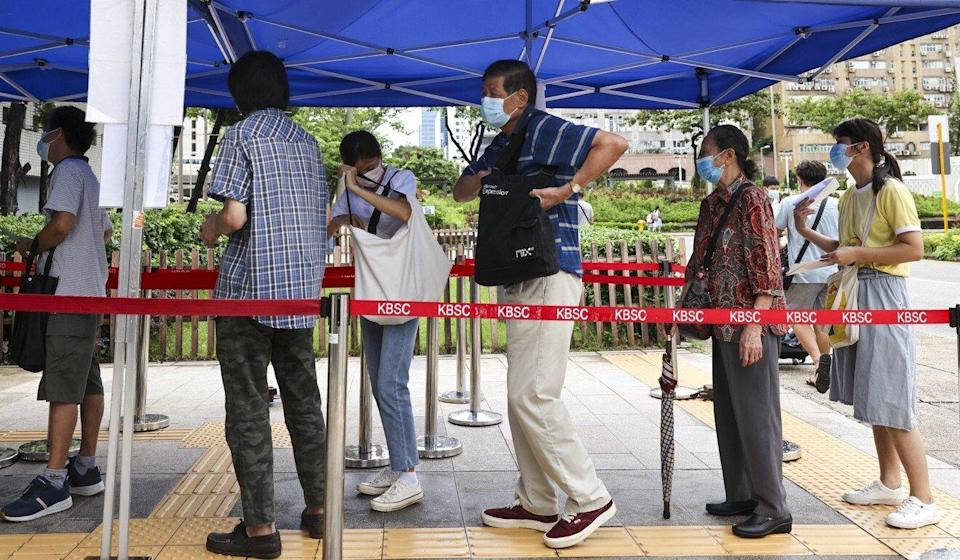 People queue for their Sinovac Covid-19 jabs in Kowloon Bay earlier this month. Photo: May Tse