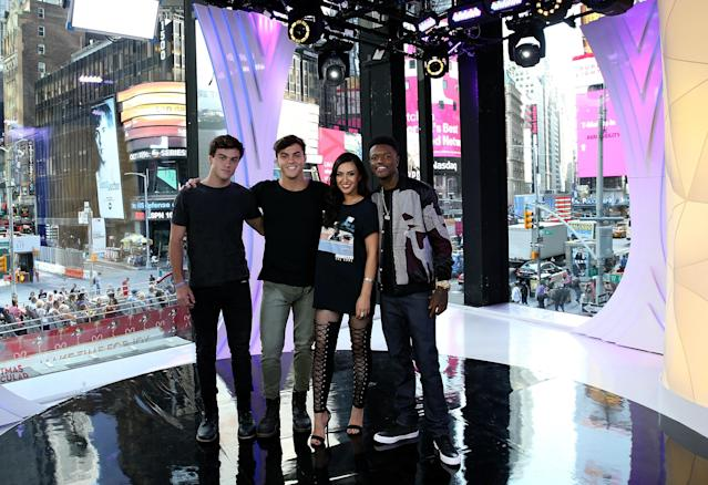 """""""TRL"""" squad members Ethan Dolan, Grayson Dolan and Tamara Dhia with """"TRL"""" host DC Young Fly in front of the MTV studio's iconic floor-to-ceiling windows. (MTV)"""