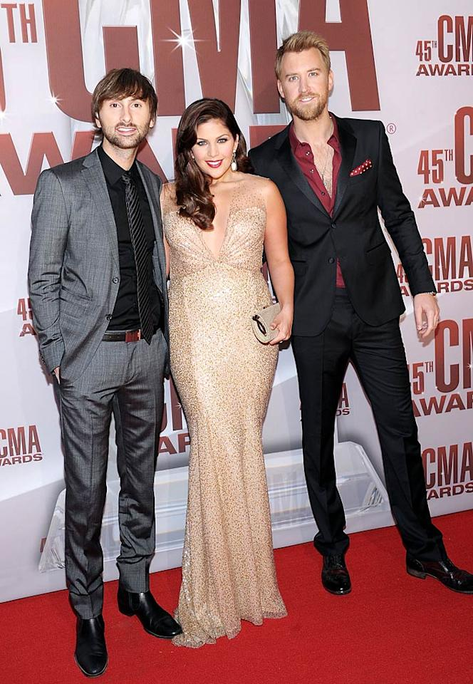 Lady Antebellum's Dave Haywood (left) and Charles Kelley were sharp in their suits, but lead singer Hillary Scott fell flat in an uncomfortable-looking  column gown. (11/9/2011)
