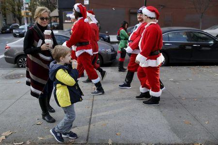 Revelers dressed in Santa Claus and other holiday themed outfits take part in the annual SantaCon event in the Brooklyn borough of New York, December 12, 2015. REUTERS/Brendan McDermid