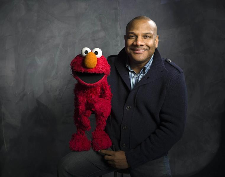 """FILE - This Jan. 24, 2011 photo shows """"Sesame Street"""" muppet Elmo and puppeteer Kevin Clash poses for a portrait in the Fender Music Lodge during the 2011 Sundance Film Festival to promote the film """"Being Elmo"""" in Park City, Utah. Clash has taken a leave of absence from the popular kids' show following allegations that he had a relationship with a 16-year-old boy. Sesame Workshop says Kevin Clash denies the charges, which were first made in June by the alleged partner, who by then was 23. In a statement issued Monday, Nov. 12, 2012, Sesame Workshop says its investigation found the allegation of underage conduct to be unsubstantiated. (AP Photo/Victoria Will, file)"""