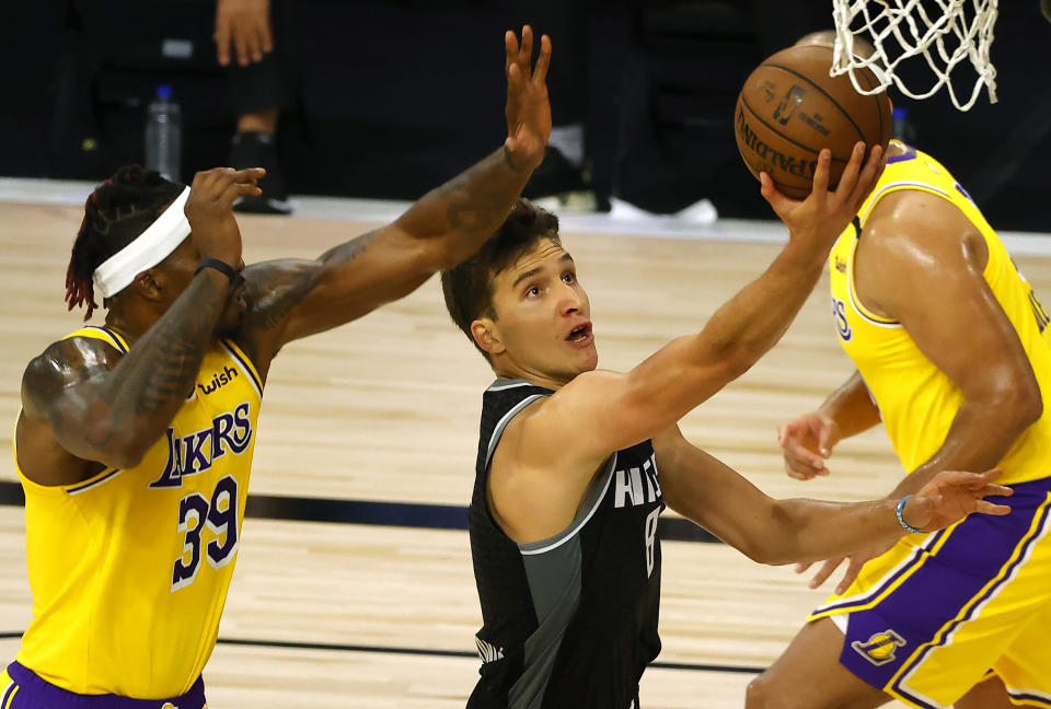 Sacramento Kings' Bogdan Bogdanovic (8) goes up for a shot against Los Angeles Lakers' Dwight Howard (39) during the second quarter of an NBA basketball game Thursday, Aug. 13, 2020, in Lake Buena Vista, Fla. (Kevin C. Cox/Pool Photo via AP)