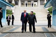 "<p>Trump <a href=""https://people.com/politics/trump-becomes-first-us-president-to-step-foot-in-north-korea/"" rel=""nofollow noopener"" target=""_blank"" data-ylk=""slk:becomes the first U.S. president"" class=""link rapid-noclick-resp"">becomes the first U.S. president</a> to set foot in North Korea on June 30, 2019, with dictator Kim Jong Un at his side. </p> <p>The moment marked the pair's third meeting, and was widely criticized by Democrats for <a href=""https://people.com/politics/trump-becomes-first-us-president-to-step-foot-in-north-korea/"" rel=""nofollow noopener"" target=""_blank"" data-ylk=""slk:glamorizing the dictator"" class=""link rapid-noclick-resp"">glamorizing the dictator</a> and not accomplishing denuclearization. It was later revealed that Trump and the authoritarian leader exchanged more than two-dozen letters during the president's tenure, <a href=""https://people.com/politics/read-the-love-letters-donald-trump-traded-with-north-korean-dictator-kim-jong-un/"" rel=""nofollow noopener"" target=""_blank"" data-ylk=""slk:complimenting each other's leadership styles"" class=""link rapid-noclick-resp"">complimenting each other's leadership styles</a>. Days before the end of Trump's term in January 2021, however, Kim Jong Un <a href=""https://www.nbcnews.com/news/world/north-korea-s-kim-threatens-build-more-nukes-bring-u-n1253625"" rel=""nofollow noopener"" target=""_blank"" data-ylk=""slk:declared the United States North Korea's &quot;arch-enemy.&quot;"" class=""link rapid-noclick-resp"">declared the United States North Korea's ""arch-enemy.""</a></p>"