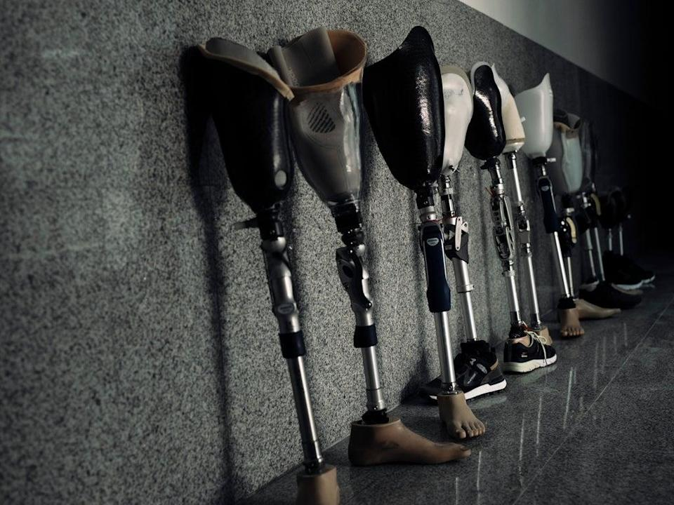 The corridors of Hamad Bin Khlifa Hospital where an assortment of trial and final-fit limbs await collection. A total of 679 Gazans have required amputation across the four wars and the Great March of Return (Paddy Dowling)