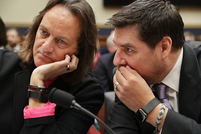T-Mobile CEO John Legere and executive chairman of Sprint Marcelo Claure talk before testifying at the House of Representatives in March 2019 (AFP Photo/CHIP SOMODEVILLA)