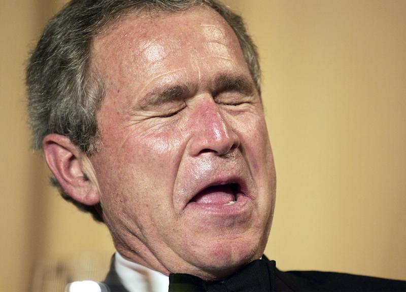 """FILE - In this May 1, 2004, file photo President George W. Bush laughs as comedian Jay Leno tells jokes at the annual White House Correspondents Association Dinner In Washington. Bush narrated a slide show at the dinner that included a photo of himself hunting around in the Oval Office and then quipped, """"Those weapons of mass destruction gotta be somewhere."""" Critics said it was a callous and cynical joke, given all those who had died in the Iraq war. (AP Photo/Gerald Herbert)"""