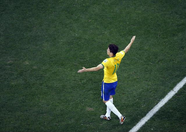Brazil's Oscar celebrates his goal in the second half during the group A World Cup soccer match between Brazil and Croatia, during the opening game of the tournament, in the Itaquerao Stadium in Sao Paulo, Brazil, Thursday, June 12, 2014. (AP Photo/Fabrizio Bensch, Pool)