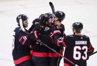 Ottawa Senators defenseman Thomas Chabot (72) gets mobbed after a goal against the Toronto Maple Leafs during the first period of an NHL hockey game Friday, Jan. 15, 2021, in Ottawa, Ontario. (Sean Kilpatrick/The Canadian Press via AP)